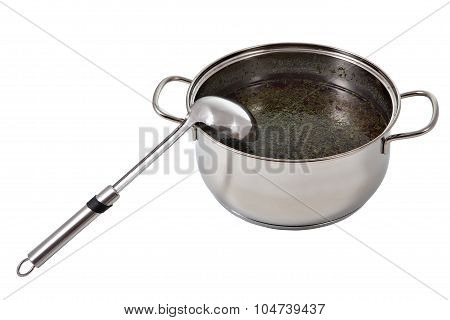 Soup Ladle Stainless Steel Lies In A Pot Of Broth.