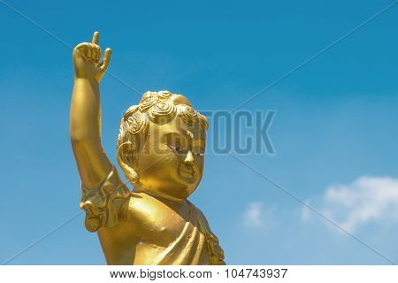 Golden Baby Buddha Statue Raise Arm And Point Forefinger Up To Blue Sky Pose