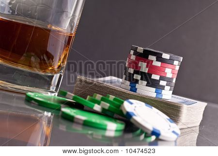 Stack Of Poker Chips On Top Of Deck With Gambling Assets