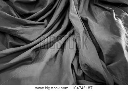 Orange Robe With Ripple  Of Thai Monk Closeup Background Black And White