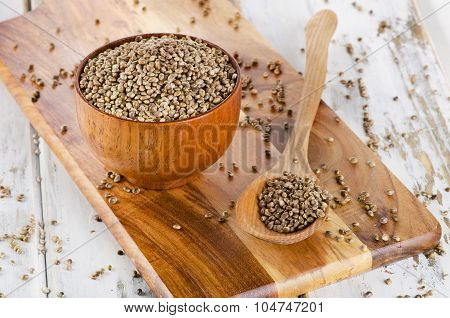 Hemp Seeds On Wooden Board.
