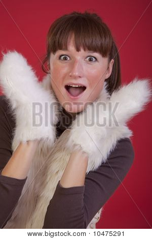 Surprised Woman In Winter Gloves