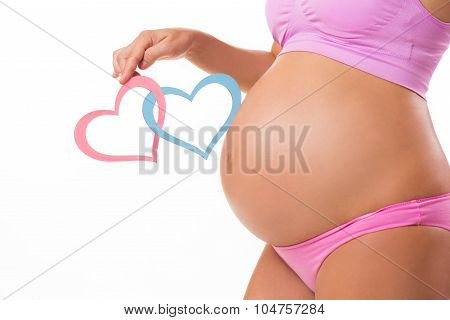 Close-up Of A Pregnant Belly With Pink And Blue Hearts. Guess The Baby-child: Girl, Boy O