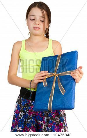 Primary Age Girl Disappointed To Receive A Gift