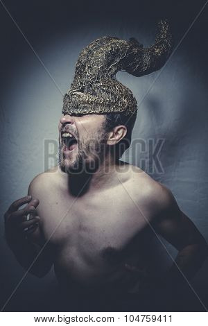 Horned, naked man with helmet warrior trumpets, and pain nightmare