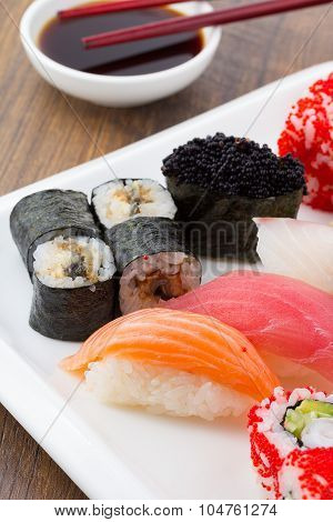 Sushi Set On A White Plate Over Vintage Wooden Background
