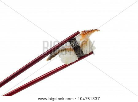 Sushi Nigiri In Brown Chopsticks Isolated On White Background