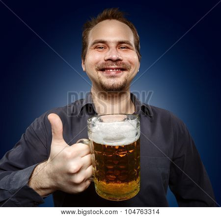 Happy Man Drinking Beer From The Mug