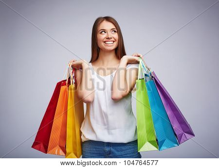 Satisfied consumer carrying multi-color paperbags