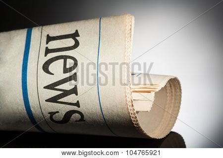 newspaper title on black background