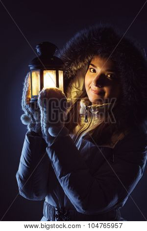 beautiful girl with lantern seeking in night