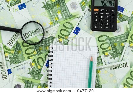 Empty notebook on euro banknotes background