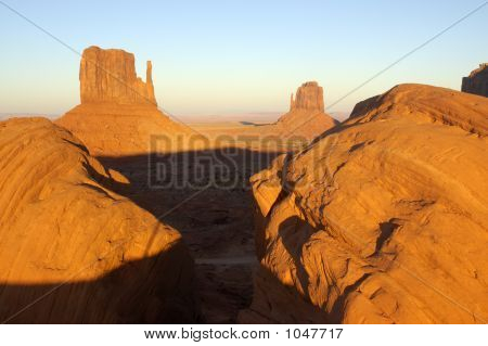 Boulders Framing Two Mittens In Monument Valley