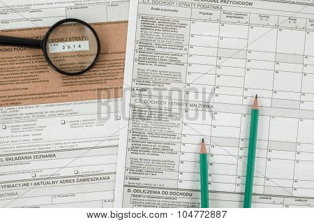 Polish tax form with pencils