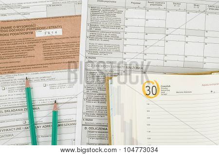 Polish tax form with pencils and calendar