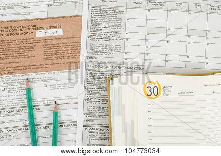 Polish tax form with pencils and calendar