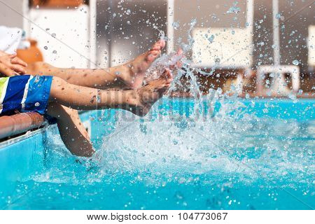 Boys Legs Splashing Water In Pool