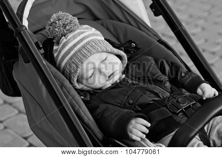 Baby Sleeps In A Red Stroller