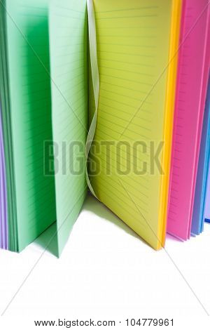 open varicolored notebook
