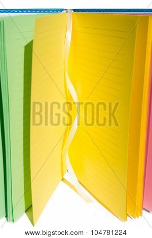 open many-colored notebook, vertical