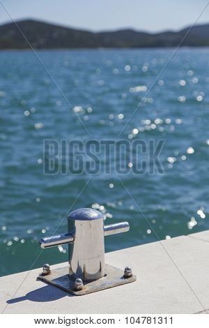 Metal bollard on the dock of pier