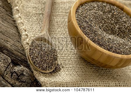 Wooden Spoon And Bowl Full Of Healthy Nutritious Chia Seeds