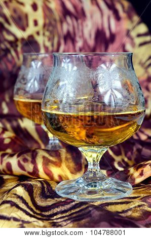 Two Glasses Of Cognac On A Colorful Background