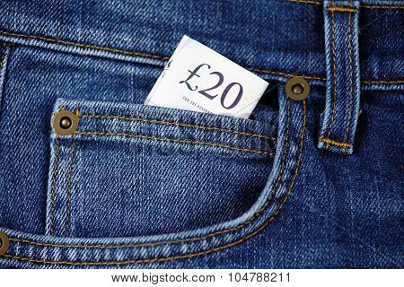 Twenty Pound Bank Banknote In The Pocket Of Jeans. United Kingdom. Background