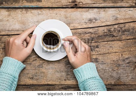 Woman's Hands Hold A Cup Of Strong Coffee.