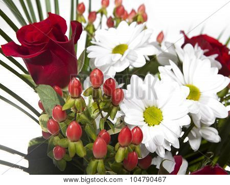 Bright bouquet with chamomiles and roses on a white background