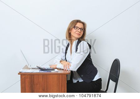 female office worker sits at her desk and look screen