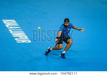 KUALA LUMPUR, MALAYSIA - OCTOBER 02, 2015: Germany's Benjamin Becker hits a backhand return in his match at the Malaysian Open 2015 tennis tournament held at the Putra Stadium, Malaysia.