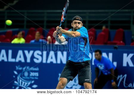 KUALA LUMPUR, MALAYSIA - OCTOBER 02, 2015: Benjamin Becker of Germany hits a backhand return in his match at the Malaysian Open 2015 tennis tournament held at the Putra Stadium, Malaysia.