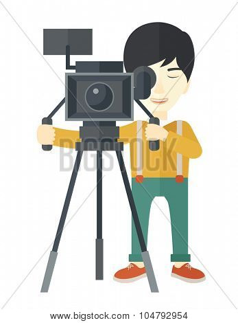 An Asian cameraman looking through movie camera on a tripod vector flat design illustration isolated on white background. Vertical layout.