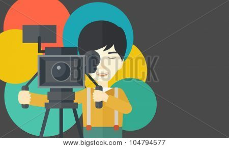An Asian cameraman looking through movie camera on a tripod vector flat design illustration. Horizontal layout with a text space.
