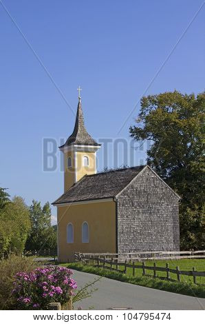 Little Chapel Beside The Road In Rural Landscape