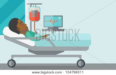 An African American patient lying in hospital bed with heart rate monitor and drop counter isolated on white background. Horizontal layout with a text space for a social media post.