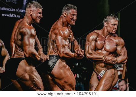 group of men bodybuilder side view showing biceps of his arms