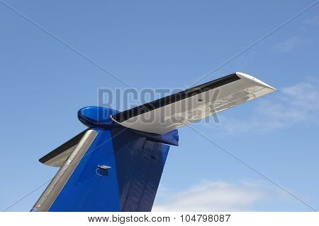 Aeroplane Wing Tale Viewed From Below With Blue Sky