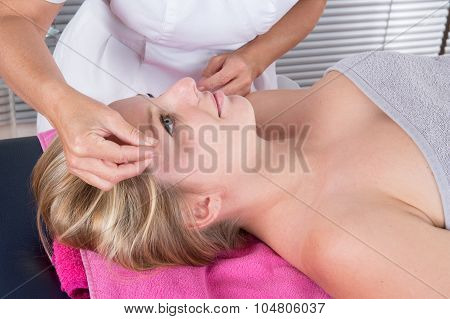 Smiling Young Man In An Acupuncture Therapy In A Spa Center