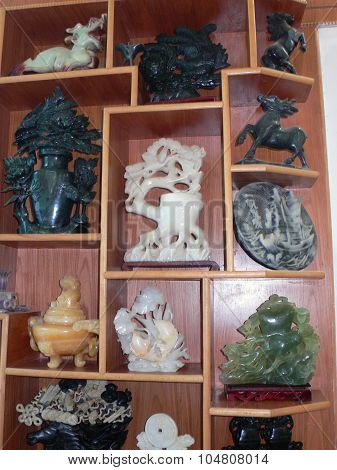 Jade carvings on shelf