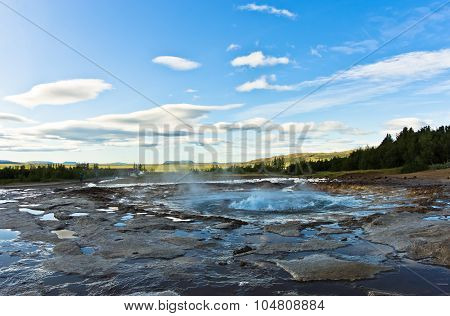 Geyser Strokkur starts bubling before eruption, Haukadalur area