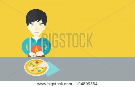 A sick asian man with heartburn due to pizza holding hands on his stomach vector flat design illustration. Horizontal layout with a text space for a social media post.