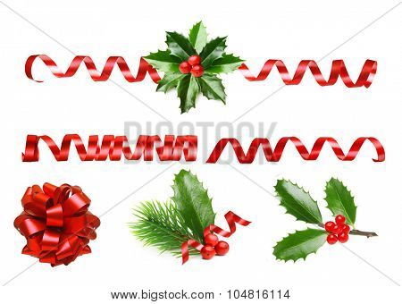 Pine tree branch, Holly berry leaves and red ribbon. Christmas decoration isolated on white background.