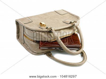 The Purse Sticks Out Of A Female Handbag