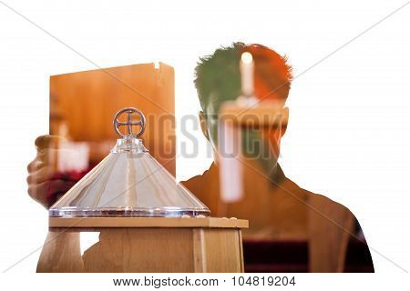 Man Figure In Silhouette Showing A Religious Book