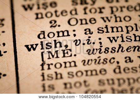 Close-up Of An Opened Dictionary Showing The Word Wish
