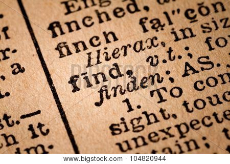 Close-up Of An Opened Dictionary Showing The Word Find