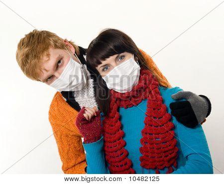 Man Embraces A Woman Wearing Masks