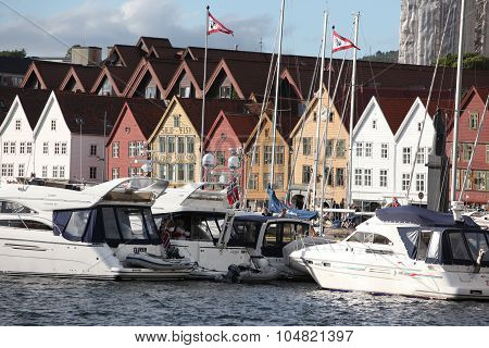 Bergen, Norway - Circa July 2012: Tourists And Locals Stroll Alo